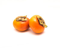 Two Fuyu persimmon isolated Royalty Free Stock Images