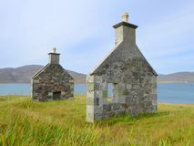 Gable ends of ruined cottage. The two gable ends of a ruined cottage on the island of Vatersay in the Western Isles of Scotland Stock Images