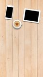 Two gadgets and coffee on a wooden table Royalty Free Stock Photos