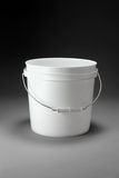 Two Gallon Pail. White two gallon pail with handle on gradated background Stock Image
