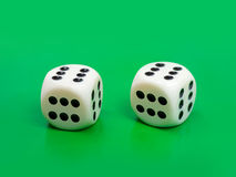 Two gambling dices - only six. Two gambling dices ( only six ) on green background Royalty Free Stock Photo