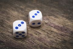 Two game dice number double three. On the wooden table Royalty Free Stock Photo