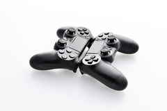 Two game pads face to face on a white background Royalty Free Stock Image