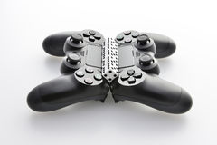Two game pads with a row of black and white dices Royalty Free Stock Photo