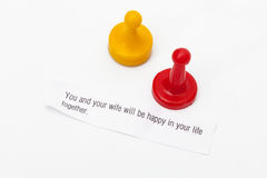 Two game tokens representing a couple, and a fortune from a fort royalty free stock photography