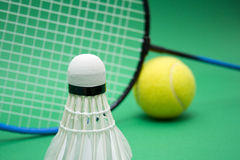 Two games. Equipment for badminton and tenis ball Stock Photo