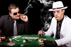 Two gangsters playing some cards Stock Image