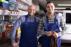 Two garage colleagues near facilities Stock Images