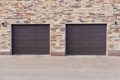 Two garage doors on brick wall. Royalty Free Stock Photos