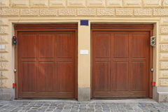 Two Garage Doors. Two Wooden Garage Doors at House Royalty Free Stock Photography