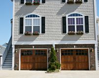 Two Garages. Beautiful architectural structure with quaint details that has two garage doors Stock Images