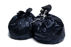 Two garbage bags. Tied up with ropes, isolated, on white background royalty free stock images