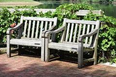 Two Garden Benches Royalty Free Stock Photos