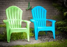 Two Garden Deck Chairs Blue and Green In Pleasant Garden Spot. Two Garden Deck Chairs Blue and Green In Pleasant Quiet Garden Spot stock images