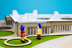 Two garden dwarfs. In front of a miniature buiding Royalty Free Stock Photography
