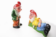 Two garden gnomes, lying and standing Royalty Free Stock Photos
