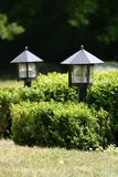 Two garden lights. In the grass Stock Images