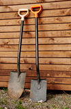 Two garden shovels. Two shovels against wooden wall Stock Photography