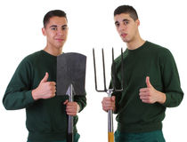 Two gardeners. One with a spade and the other with a fork Stock Images
