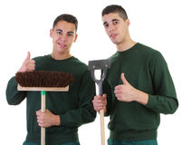 Two gardeners. One with a broom and the other with a hoe Royalty Free Stock Photo