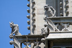 Two gargoyles on a balcony Royalty Free Stock Image
