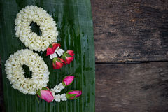 Two garland on banana leaf for worship Stock Images