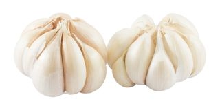 Two Garlic Bulbs and Garlic Cloves on White Background. Vegetable and Herb, Two Fresh Organic Garlic Bulbs and Garlic Cloves Used for Seasoning in Cooking Royalty Free Stock Image