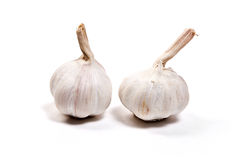 Two garlic bulbs isolated on white background Royalty Free Stock Photography