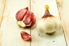 Two  garlic on the table Stock Photos
