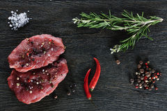 Two garnished raw beef steaks Stock Image