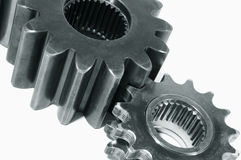 Two gears against white royalty free stock images