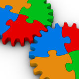 Two gears of colorful jigsaw puzzles. On white background Royalty Free Stock Photos
