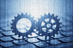 Two gears on computer keyboard Stock Image