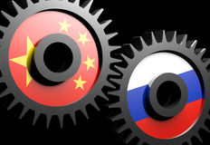 Two gears with the flags of China and Russia. On black background Royalty Free Stock Photos