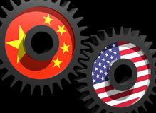 Two gears with the flags of China and USA Royalty Free Stock Image