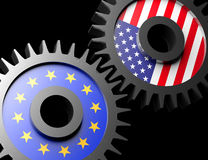 Two gears with the flags of usa and European union Stock Images