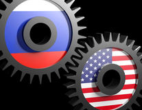 Two gears with the flags of usa and Russia. On black background Stock Photo