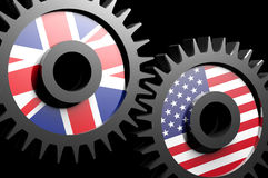 Two gears with the flags of USA and UK Royalty Free Stock Images