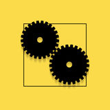 Two gears on a yellow background. Stock Photography