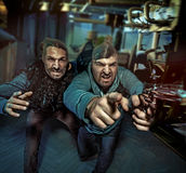 Two geek guys making a robbery. Two boys guys making a robbery Stock Photo