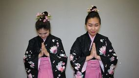 Two geiha greeting. Two geisha in traditional japanese kimono greeting stock video