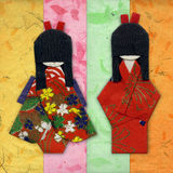 Two Geisha Origami Friends. On colored handpapers Royalty Free Stock Photo