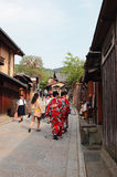 Two geisha in red Kimono at well-known Gion area Stock Images