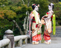 Two geishas in Japanese garden Stock Photography