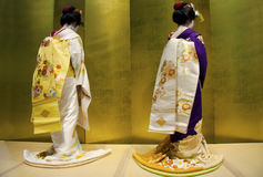 Two geishas with a golden background Royalty Free Stock Photo