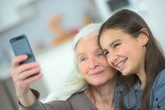 Two generation women making funny selfie together Royalty Free Stock Photography
