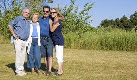 Two generations. Happy two older couples posing in the summer royalty free stock photos