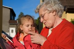 Two generations. Great grandma and great-grandchild Royalty Free Stock Image