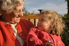 Two generations. Great-grandmother and great-granddaughter Royalty Free Stock Images