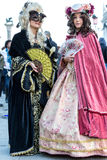 Two generations in beautiful costumes on Venetian carnival 2014, Venice, Italy Royalty Free Stock Photography